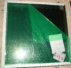 Fitting glass to the flatplate solar collector using angle strips and silicon sealant
