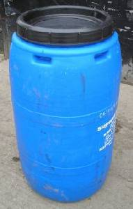 Blue plastic storage tub converted to be used as a water butt