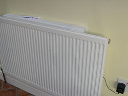 Radiator Booster sat on top of a standard domestic radiator