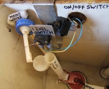 Rainwater toilet flush system