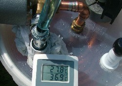Indoor / outdoor thermometer used to measure ambient air temperature and temperature of heated water