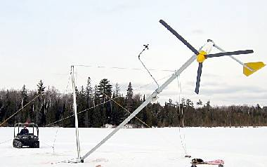 Tilt-up wind turbine tower being winched up