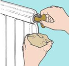 Bleeding a radiator by hand using a radiator key