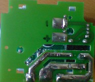 Battery contacts on the underside of the relay board