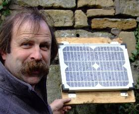 Dick Strawbridge and a Solar Panel used to power PC fan in a greenhouse heatsink system