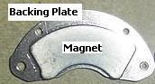 Hard disk drive magnet still attached to backing plate