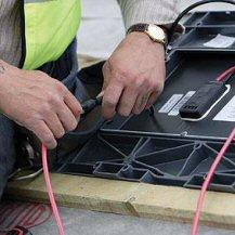 Wiring up solar roof tiles - solarcentury