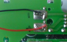 Positive and negative leads soldered to the battery bay contacts