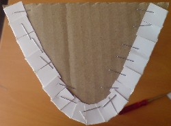End view of parabolic trough prototype. Staples used to hold mirrored card to end supports
