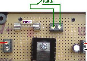 12 VOLT REGULATOR WITH FUSE AND SWITCH TERMINALS. Supply a fixed 12.0 Volt DC to your devices (up to 1 Amp output). Includes fitted 1A fuse, 2 spare fuses, and terminals for connection of a switch